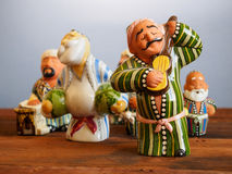 Traditional Uzbek souvenirs - handmade ceramic figurine. On wooden table Royalty Free Stock Image