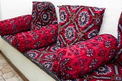 Traditional Uzbek textured sofa. In interior Royalty Free Stock Images
