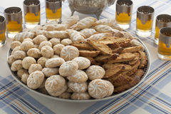 Traditional variety of Moroccan cookies with tea Royalty Free Stock Image