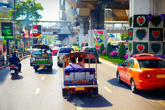 Traditional vehicles moving on the main road in Bangkok, Thailand Stock Photography