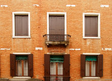 Traditional venetian architecture. Detail - windows of house Stock Photos