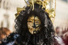 Traditional venetian carnival costume mask. Venetian carnival costume mask during traditional masquerade in city of Venice Italy Stock Photos