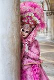 Venetian masked model from the Venice Carnival 2015 with near Plaza San Marco, Venezia, Italy. Traditional venetian masked carnival lady near piazza San Marco stock images