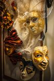 Traditional Venetian masks for carnival in showcase street shop. Carnival of Venice. Souvenirs from Italy Stock Photo