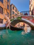 Traditional Venice Gondola Ride along Narrow Canal, Venice, Ital Royalty Free Stock Image