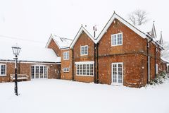 Large Victorian house in winter. A traditional Victorian coach house covered in snow in winter. Buckingham, UK stock photography