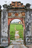 Traditional vietnamese entrance door in the imperial city, Hue, Vietnam, on a foggy day. Royalty Free Stock Photo