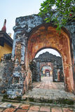 Traditional vietnamese entrance door in the imperial city, Hue, Vietnam, on a foggy day. Stock Photos