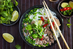 Traditional Vietnamese soup Pho with beef and rice noodle. S, top view Royalty Free Stock Photo