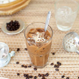 Traditional Vietnamese, Thai Ice coffee with beans on wooden background Royalty Free Stock Images