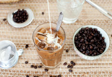 Traditional Vietnamese, Thai Ice coffee with beans on wooden background Royalty Free Stock Image