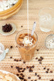 Traditional Vietnamese, Thai Ice coffee with beans on wooden background Royalty Free Stock Photography