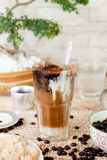 Traditional Vietnamese, Thai Ice coffee with beans on wooden background Stock Photos