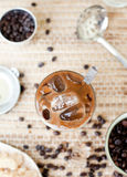 Traditional Vietnamese, Thai Ice coffee with beans on wooden background Stock Photography