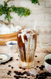 Traditional Vietnamese, Thai Ice coffee with beans on wooden background Royalty Free Stock Photo