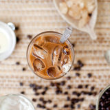 Traditional Vietnamese, Thai Ice coffee with beans on wooden background Royalty Free Stock Photos