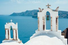 Traditional view of the sea with two white bell towers on the island of Santorini Royalty Free Stock Image