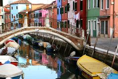 Traditional view of Burano. (Venice, Italy). Colored houses, canal and bridge Stock Photos