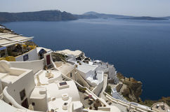 Traditional view of houses above the sea in Oia, Santorini, Greece. Stock Photography