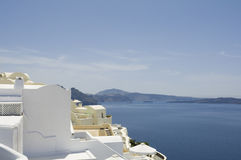 Traditional view of houses above the sea in Oia, Santorini, Greece. Stock Images