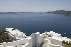Traditional view of houses above the sea in Oia, Santorini, Greece. Stock Photo