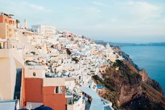 Traditional view of the island of Santorini at sunset with white, blue and orange buildings royalty free stock photography