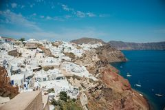 Traditional view of white houses and sea with boats on the island of Santorini. Traditional view of white houses and blue sea with boats on the island of Stock Images