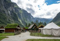 Traditional viking village with dramatic mountains and fjord in the background. stock image