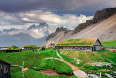 Free Traditional Viking Village. Wooden Houses Near The Mountain Firs Royalty Free Stock Photography - 86400407