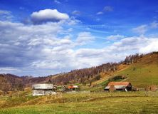 Traditional village in Carpathians in an autumn sunny day. royalty free stock photography