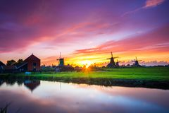 Traditional village with dutch windmills and river at sunset, Holland, Netherlands. Royalty Free Stock Photography