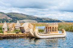 Traditional village on floating islands on lake Titicaca in Peru Stock Images