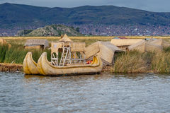 Traditional village on floating islands on lake Titicaca in Peru Royalty Free Stock Photos