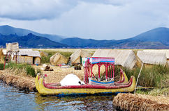 Traditional village on floating islands on lake Titicaca in Peru Royalty Free Stock Photo