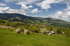 Traditional village at the foot of the mountain, spring Royalty Free Stock Photo