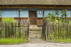 Traditional village historical building of Western Ukraine, where the roof is covered with wooden tiles. Skansen Uzhhorod. Ukraine.  Royalty Free Stock Images