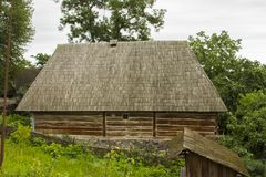 Traditional village historical building of Western Ukraine, where the roof is covered with wooden tiles. Skansen Uzhhorod. Ukraine.  Stock Image
