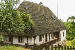 Traditional village historical building of Western Ukraine, where the roof is covered with wooden tiles. Skansen Uzhhorod. Ukraine.  Stock Photos