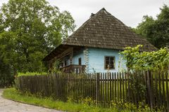 Traditional village historical building of Western Ukraine, where the roof is covered with wooden tiles. Skansen Uzhhorod. Ukraine.  Stock Images