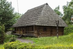 Traditional village historical building of Western Ukraine, where the roof is covered with wooden tiles. Skansen Uzhhorod. Ukraine.  Royalty Free Stock Photo