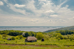 Traditional village house near the river landscape Royalty Free Stock Images