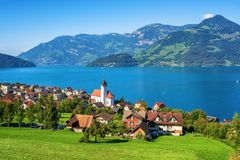 Traditional village on Lake Lucerne in swiss Alps, Switzerland royalty free stock photos