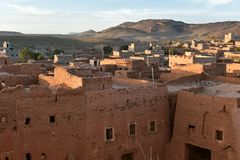 Traditional village in Morocco at sunrise. Traditional mudbrick houses in a village, Atlas Mountains, Morocco. Aerial view at sunrise Stock Photo