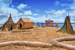 Traditional village on  Uros islands on lake Titicaca in Peru Royalty Free Stock Photo