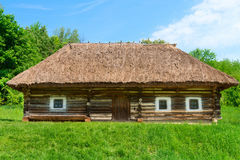 Traditional village wooden house in green country area Royalty Free Stock Images