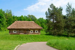 Traditional village wooden house in green country area Royalty Free Stock Image