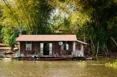 Traditional vinatge local floating house or raft house in river,. MAR 2, 2018 Uthaithani - Thailand : Traditional vinatge local floating house or raft house in Stock Image