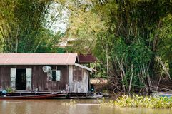 Traditional vinatge local floating house or raft house in river,. MAR 2, 2018 Uthaithani - Thailand : Traditional vinatge local floating house or raft house in Stock Photo
