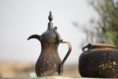 Traditional vintage arabian old smoked coffee maker. In Bedouins camp. Put on the old table. With vintage tea maker royalty free stock image