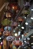 Traditional Vintage Turkish Lamp. Traditional bright decorative hanging Turkish lamps and colourful lights with vivid colours  in the Istanbul Bazaar, Turkey Royalty Free Stock Images